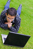 Teen student with laptop. Teen student boy and laptop Royalty Free Stock Photos