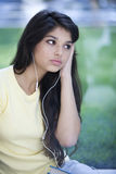 Teen student listening music Royalty Free Stock Images