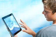 Teen student navigating on tablet. Royalty Free Stock Photo