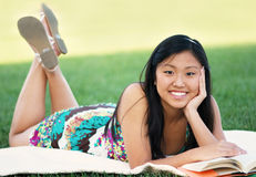 Teen Student Reading At The Park Stock Photos
