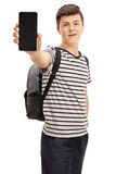 Teen student showing a phone to the camera. On white background Royalty Free Stock Images