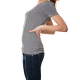 Teen student woman with back pain. Isolated Royalty Free Stock Photography