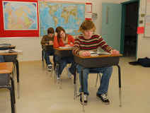 Teen Students in Classroom. Young teenage students study in a classroom Stock Photos