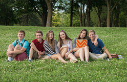 Teen Students Sitting Outdoors Stock Image