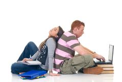 Teen students working on laptop Royalty Free Stock Photos