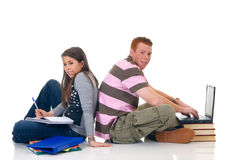 Teen students working on laptop Stock Images