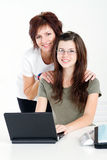 Teen studying. Overhead view of middle aged mother helping teen daughter studying computer Royalty Free Stock Photo