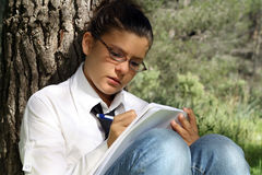 Teen studying writing Royalty Free Stock Photography