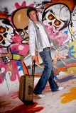 Teen suitcase graffiti wall Royalty Free Stock Photography