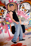Teen suitcase graffiti wall Royalty Free Stock Photos