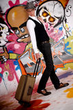 Teen suitcase graffiti wall Royalty Free Stock Photos