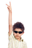 Teen with sun glasses hand up Royalty Free Stock Image