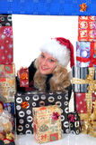 Teen surrounded in xmas gifts Royalty Free Stock Photo