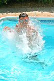 Teen in swimming pool. Teen having fun in swimming pool Royalty Free Stock Photo