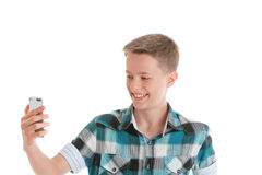 Teen takes pictures of his self-portrait, selfie Stock Photo