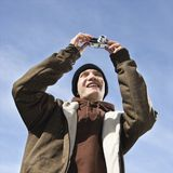 Teen taking picture. Royalty Free Stock Images