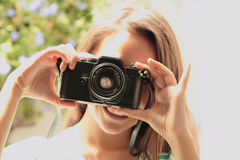 Teen taking pictures of the retro camera Royalty Free Stock Image