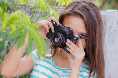 Teen taking pictures Royalty Free Stock Photography