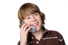 Teen talking on Cell Phone. A young teen is happy with his first cell phone Royalty Free Stock Photos