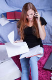 Teen talking with friend before exam. Teen girl talking with friend by phone before exam Stock Photography