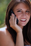 Teen Talking on Her Cell Phone Outdoors (1) Stock Photo