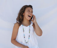 A teen talking on the phone. A teen girl is talking on her cell phone stock images
