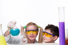 Teen and teacher of chemistry at  lesson making Stock Image