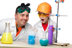 Teen and teacher of chemistry at  lesson making Stock Photography