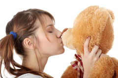 Teen with teddy bear Stock Images