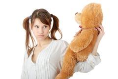 Teen with teddy bear Royalty Free Stock Photos