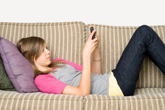 teen texting Arkivfoto