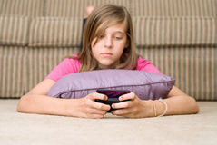 Teen Texting. Teen or pre teen girl texting on her cell phone Stock Photography