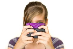 Teen Texting. Teen or pre teen girl texting on her cell phone Stock Images