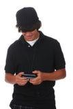 teen texting Fotografering för Bildbyråer