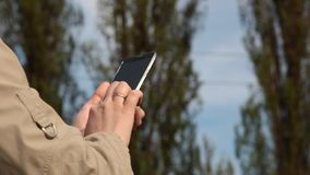 A teen texts on her cell phone stock footage