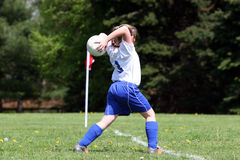 Teen Throwing Soccer Ball. On to field during game Stock Image