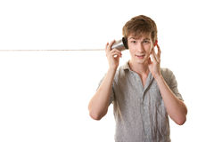 Teen With Tin Can Telephone Royalty Free Stock Images