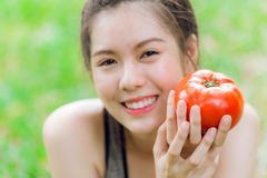 Teen with Tomato smile happy good healthy skin stock images