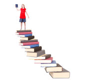 Teen on top of book staircase Royalty Free Stock Photography