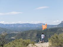 Teen on top of a mountain with Catalonian flag. A Teen on top of a mountain with Catalonian flag Stock Photos
