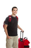 Teen traveler. A teen boy traveler with luggage isolated on white Royalty Free Stock Photography