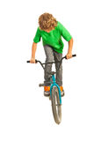 Teen trying a stunt on bike. Teen boy trying a stunt on bike isolated on white background royalty free stock photography