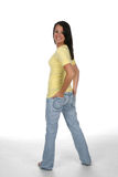 Teen turning with hands on hips Stock Photo