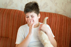 Teen turns due to unpleasant odor from cat Royalty Free Stock Images