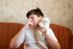 Teen turns due to unpleasant odor from cat Stock Photography