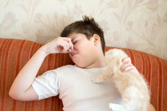 Teen turns due to unpleasant odor from cat Stock Photo