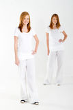 Teen twin sisters stock image
