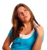 Teen Twirling hår Arkivfoto