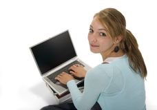 Teen using laptop computer. Teenage girl woking on laptop computer Stock Image