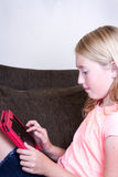 Teen using tablet Royalty Free Stock Images
